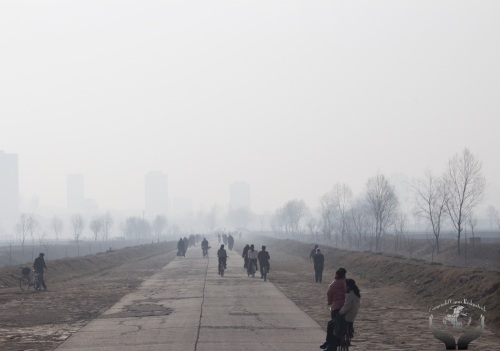 Cold, foggy walk to school outside PyongYang