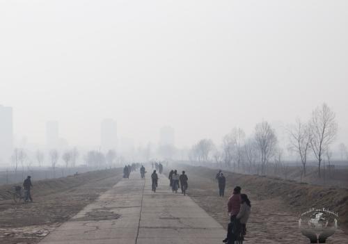 Cold, foggy walk to school outside PyongYang